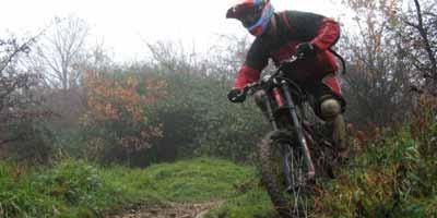 Brett riding a rocky corner on Leckhampton Hill